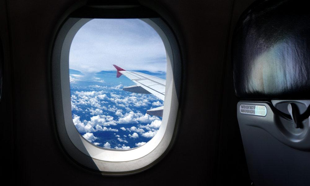 چرا پنجره های هواپیما گرد است؟