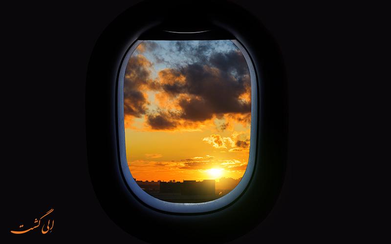غروب از شیشه هواپیما